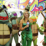 The Teenage Mutant Ninja Turtles get interviewed at the Nickelodeon booth during the 2014 San Diego Comic-Con International - Day 2 on July 24, 2014 in San Diego, California.