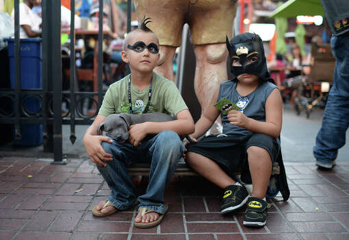 Seven-year-old Ashton Ritz (L) and four-year-old Dezmen Olivas sit together on the first day of the 45th annual Comic-Con, in San Diego, California July 24, 2014.  The four-day pop culture extravaganza celebrates film, TV, video games, comic books, costumes and other popular arts. More than 150,000 fans are expected to attend the sold-out event. Photo: ROBYN BECK, AFP/Getty Images / AFP