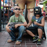 Seven-year-old Ashton Ritz (L) and four-year-old Dezmen Olivas sit together on the first day of the 45th annual Comic-Con, in San Diego, California July 24, 2014.  The four-day pop culture extravaganza celebrates film, TV, video games, comic books, costumes and other popular arts. More than 150,000 fans are expected to attend the sold-out event.