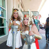 Costumed fans Alexa Kiss (L) and Nicolle Hanbury pose for photos outside the San Diego Convention Center on July 24, 2014 in San Diego, California.