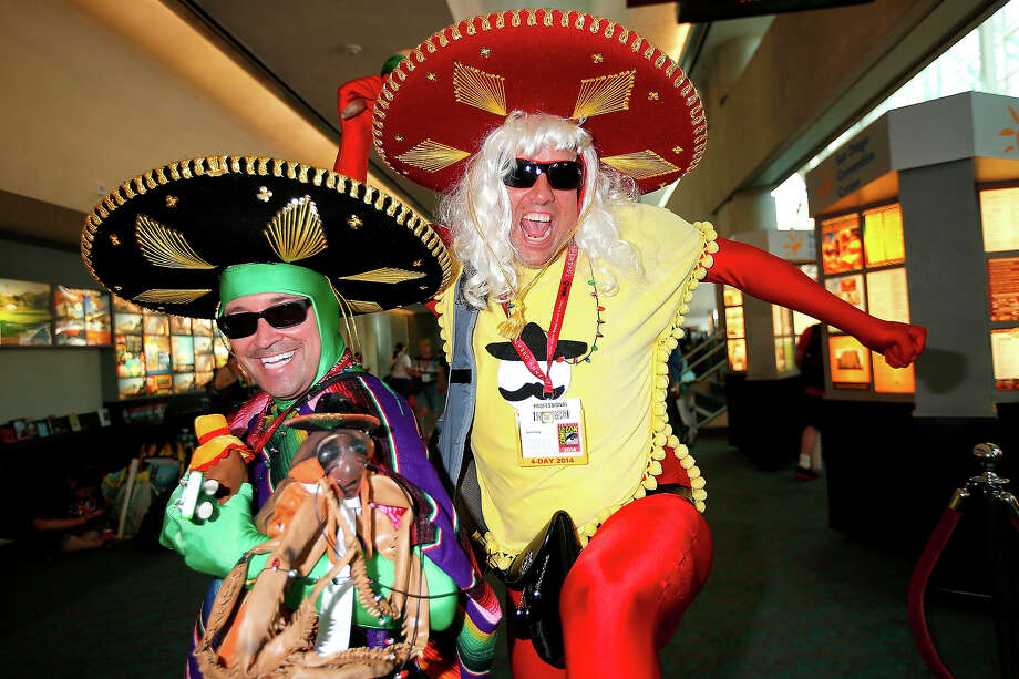 Costumed fans Mike Phillips (L) and Sean Craig pose for photos at San Diego Convention Center on July 24, 2014 in San Diego, California. Photo: Daniel Knighton, WireImage / 2014 Daniel Knighton