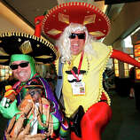 Costumed fans Mike Phillips (L) and Sean Craig pose for photos at San Diego Convention Center on July 24, 2014 in San Diego, California.