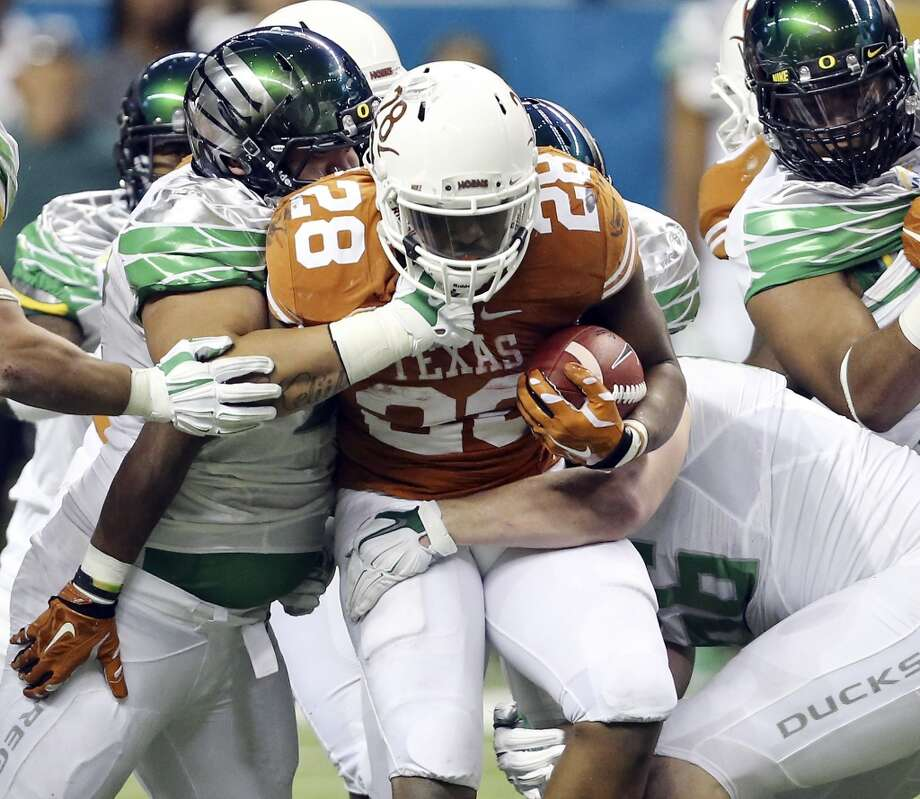 2013: Valero Alamo Bowl saw the Oregon Ducks take down Texas in a rout, 30-to-7, before a crowd of 65,918. It was the final game coaching the Longhorns for longtime UT coach Mack Brown. Photo: Edward A. Ornelas, San Antonio Express-News