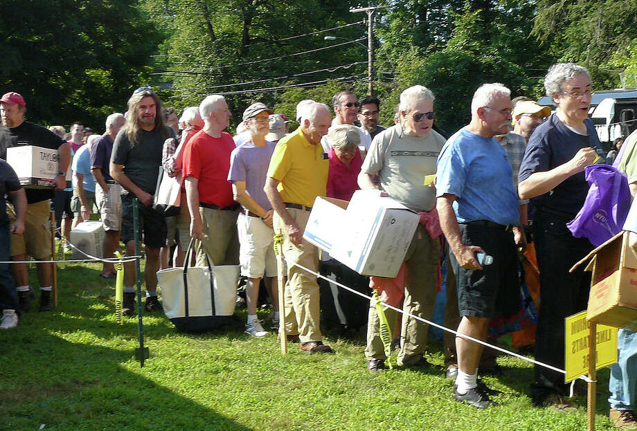 Buyers, with bags and boxes ready, line up on the opening day of the Pequot Library Annual Book Sale. Photo: Staff Photo/Gretchen Webster / Fairfield Citizen