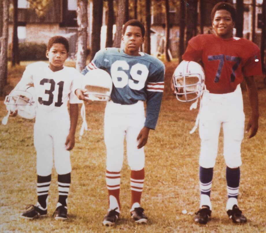 Former New York Giants and newly-elected Hall of Fame defensive end Michael Strahan, left, is shown in this undated family photo with his brothers, Victor (69) and Christopher (77). Photo: Brett Coomer, Strahan Family