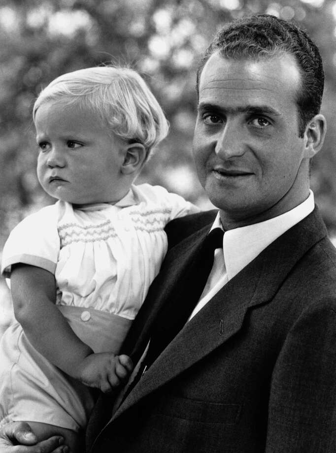 Another photo of King Juan Carlos I of Spain with his baby son, Prince Felipe, in July of 1969. Felipe is now King.  Photo: Express, Getty / 2007 Getty Images