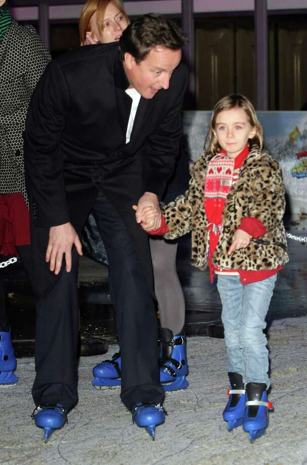 Nancy Cameron, daughter of British prime minister David CameronNancy Cameron (right) holds her father's hand while ice skating in Hyde Park in November of 2009. In 2012, the British tabloids tweeted that Nancy was accidentally left at a pub by the British leader and his wife after a night of drinking. The couple left in separate cars, each thinking the other had Nancy.  Photo: Danny Martindale, Getty / WireImage