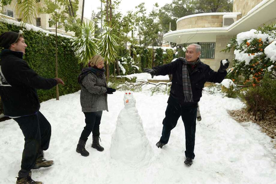 Yair Netanyahu, son of Israeli prime minister Benjamin NetanyahuIsraeli Prime Minister Benjamin Netanyahu playfully throws a snowball at his son in 2013 in Jerusalem.  Photo: GPO, Getty / 2013 GPO