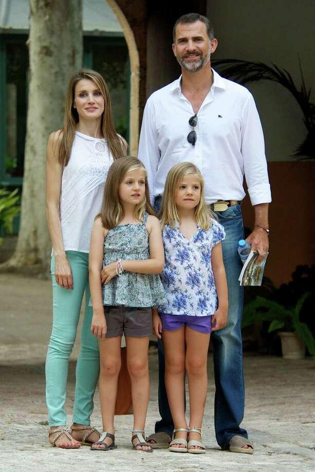 """Princesses Leonor and Sofia, daughters of Spanish King Felipe VIPrincess Leonor of Spain, center left, and Princess Sofia of Spain, center right, visit """"La Granja"""" in 2013 in Palma de Mallorca. Photo: Carlos R. Alvarez, Getty / 2013 Carlos R. Alvarez"""