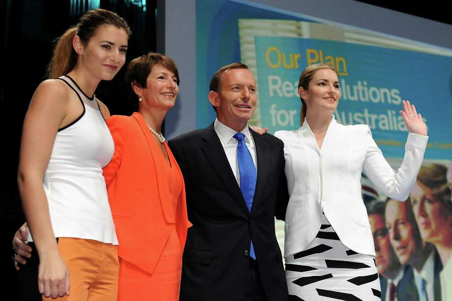 "Bridget and Frances Abbott, daughters of Australian prime minister Tony AbbottBridget, far right, and Frances, far left, are pictured during the 2013 Coalition Campaign Launch in Brisbane on August 25, 2013. Tony Abbott stands third from the left.Bridget might have thought about dressing up for her dad's candidacy announcement, but then she thought, ""eh, I want to be comfy.""   Photo: Matt Roberts, Getty / 2013 Getty Images"