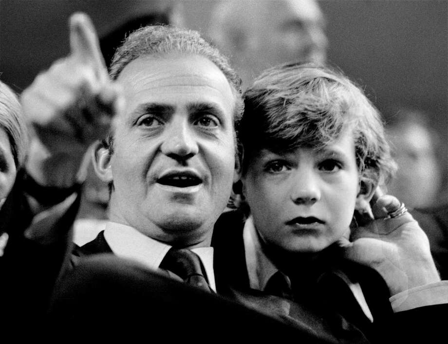 King (then Prince) Felipe VI, son of Spanish King Juan Carlos. Juan Carlos, King of Spain, and his son  watch a tennis match in Madrid in 1977. King Carlos renounced the throne after 39 years and was succeeded by his son earlier this year.  Photo: Daniel Gluckman, Getty / 2014 Getty Images
