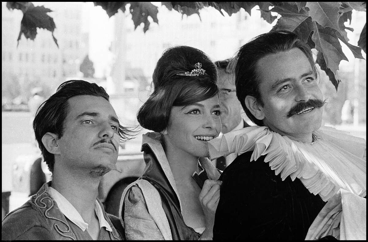 Sandra Archer (center) in commedia costume with two fellow cast members from the San Francisco Mime Troupe, waiting to go onstage in the 1960s (1964 or '65)