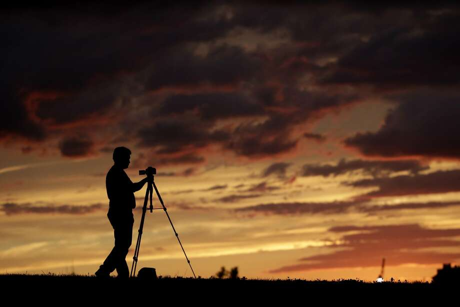 Twilight gleaming: Bill Cunningham snaps the setting sun during an outing at Liberty State Park in Jersey City, N.J. 