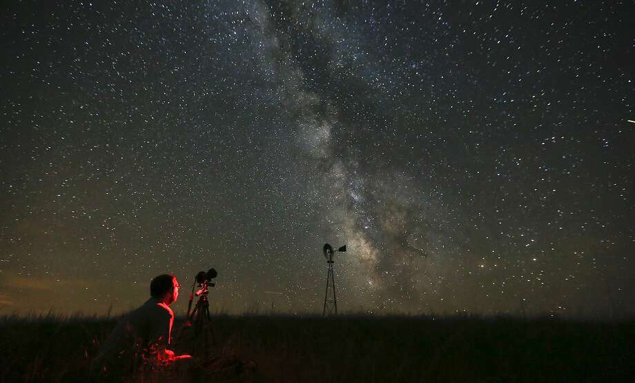 Shooting stars: Omaha photographer Lane Hickenbottom photographs the night sky in a pasture near Callaway, Neb. 