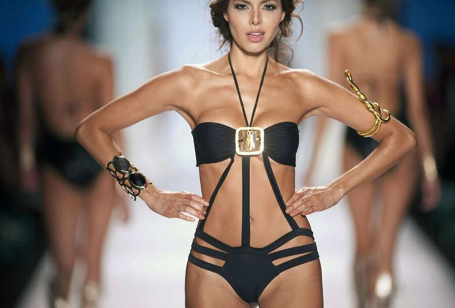 Unusual braceletsaccent an exotic, if not exactly modest, design by Colombian designer Carmen Belissa at Colombiamoda fashion show in Medellin. Photo: Raul Arboleda, AFP/Getty Images