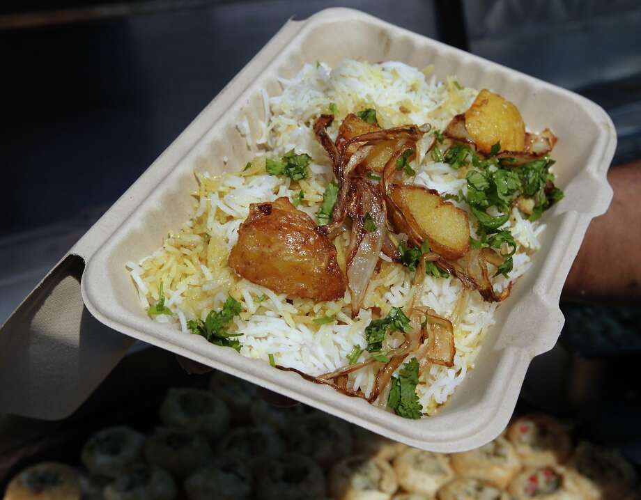 An order of chicken biryani, prepared by Rupam Bhagat, is served at his Dum food truck. Photo: Paul Chinn, The Chronicle