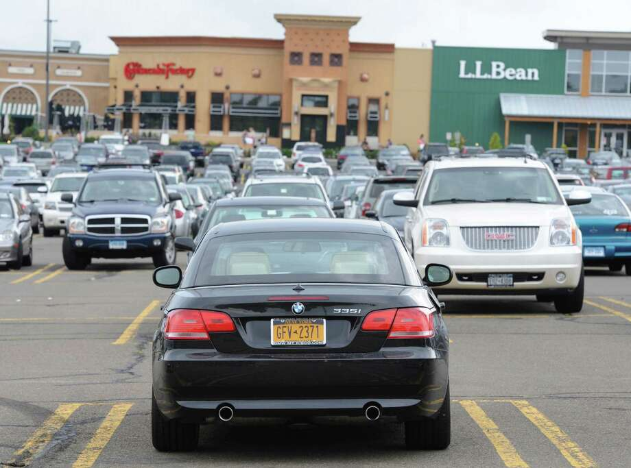 An out-of-state shopper is parked in the parking lot at the Danbury Fair in Danbury, on Thursday, Aug. 22, 2013. The mall is becoming a destination shopping area, seeing an increase in out-of-state shoppers with the upscaling of its tenants. Photo: Tyler Sizemore, File Photo / The News-Times