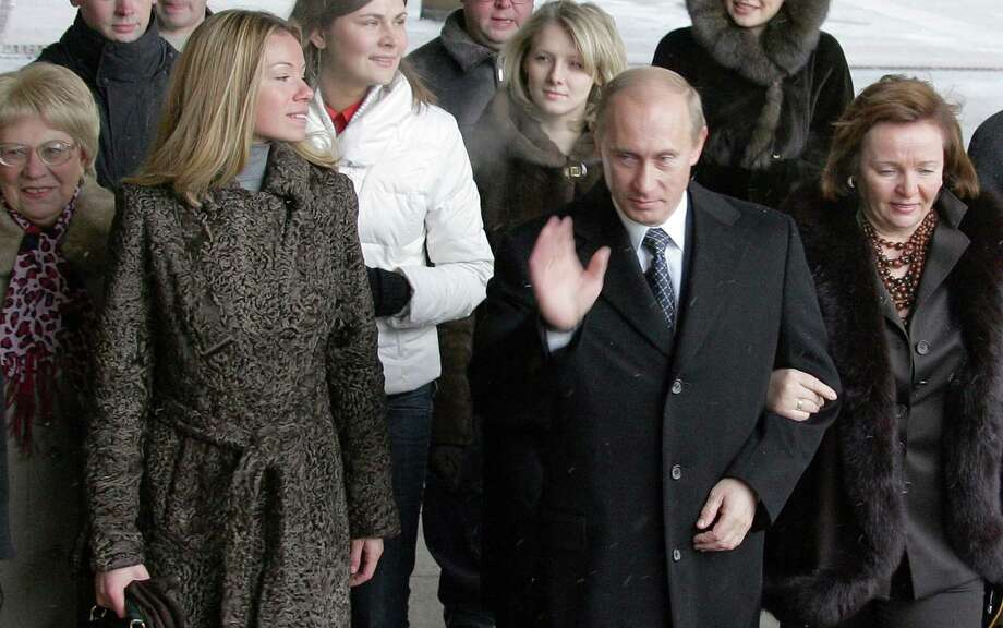 Maria Putin, daughter of Russian President Vladimir PutinMaria Putin (second on left), made headlines yesterday after various media sites reported that the daughter of Russian President Vladimir Putin (center) had been forced to flee the home of her Dutch boyfriend, Jorrit Faassen, when protesters surrounded the couples' upscale apartment. The protesters blame Maria's father for the deaths of those aboard flight MH17, a Malaysian airline shot down over eastern Ukraine last week.Maria, who goes by Masha, is 29, and is rarely photographed. In this 2007 photo, the Putins (including wife Ludmilla, right) enter a polling place before elections. Politics is serious, but kids are cute! Across the world, royals, presidents and political dynasties all balance the demands of ruling with the trials of parenthood. Click through for a slideshow of more offspring of current world leaders.  Photo: ALEXANDER NEMENOV, Getty / AFP