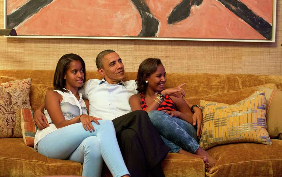 Malia and Sasha Obama, daughters of U.S. President Barack ObamaThe first teens, Malia (left) and Sasha (right) are often photographed with their famous Dad. Malia, now 16, and Sasha, currently 13, both live in the White House in Washington.  Photo: The White House, Getty / 2012 The White House