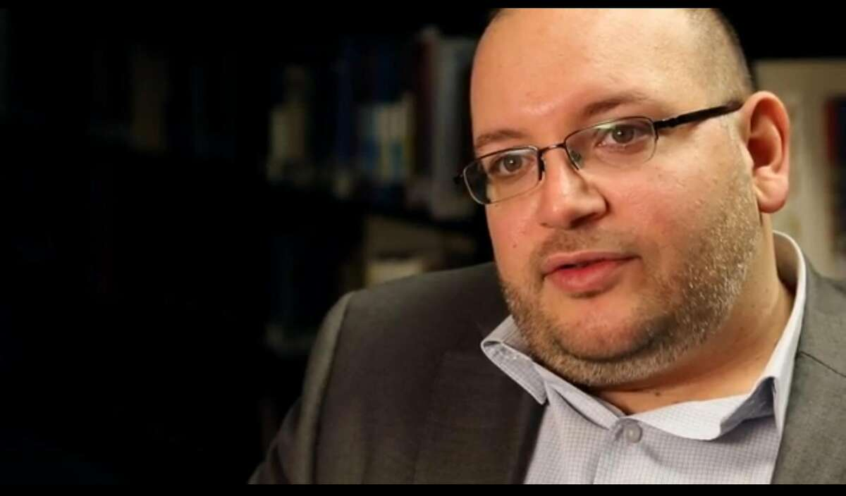 A Nov. 6, 2013, photo shows Jason Rezaian, a Washington Post reporter, at the newspaper in Washington. Three Americans, including Rezaian, appear to have been detained in Iran, the newspaper said Thursday, July 24, 2014. The other two Americans, who have not yet been identified, work as freelance photojournalists.