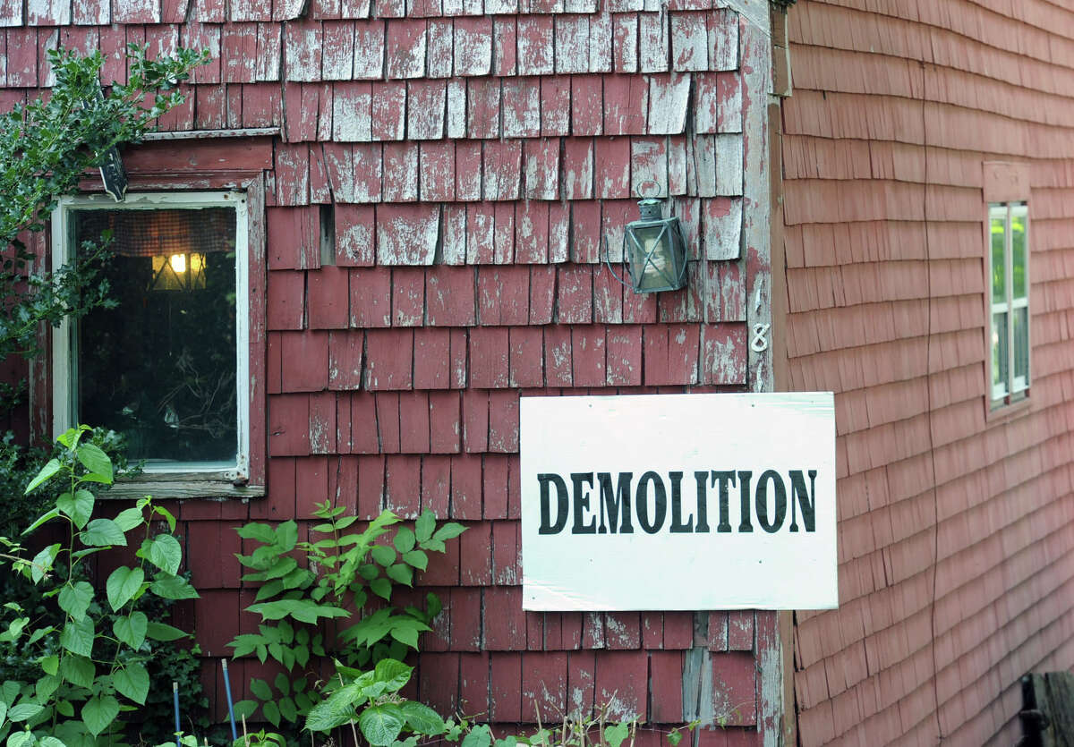 A demolition sign attached to the house at 181 Shore Rd., in Old Greenwich, Conn., Friday, July 25, 2014.