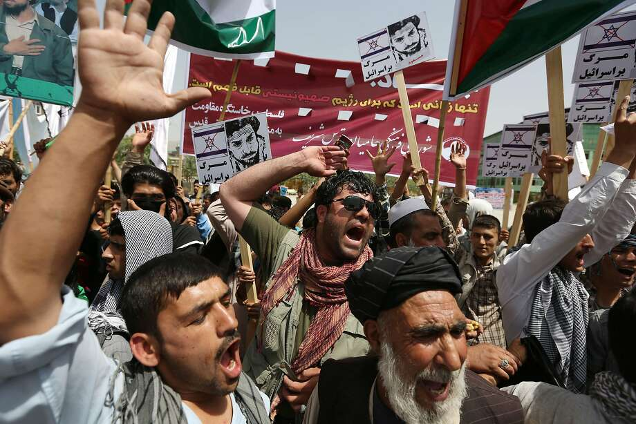 Afghan demonstrators shout slogans against Israel during a rally marking Al-Quds (Jerusalem) Day in Kabul, Afghanistan, Friday, July 25, 2014. Hundreds of demonstrators took to the streets of Kabul on Friday to mark Al-Quds Day, the last Friday of the Islamic holy month of Ramadan, shouting their support for the Palestinian people and highlighting the importance of the city of Jerusalem to Muslims. (AP Photo/Rahmat Gul) Photo: Rahmat Gul, Associated Press