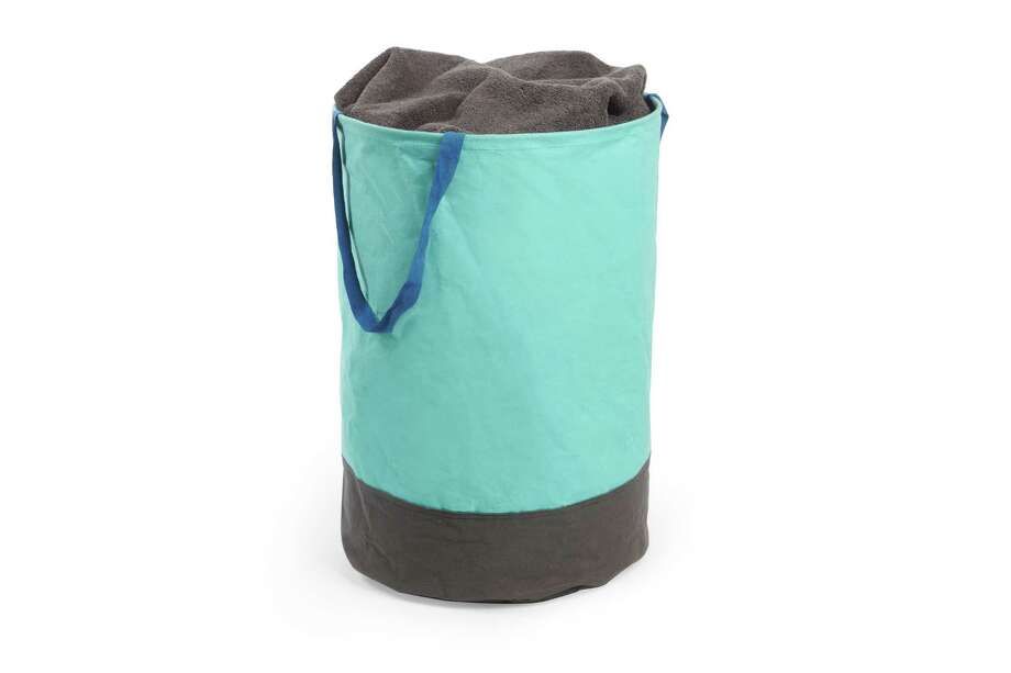 Instead of: A plastic laundry binChoose: A lighter option that's easy to carry and store. Umbra Crunch large round bin, $20 at The Container Store Photo: Umbra / ONLINE_YES