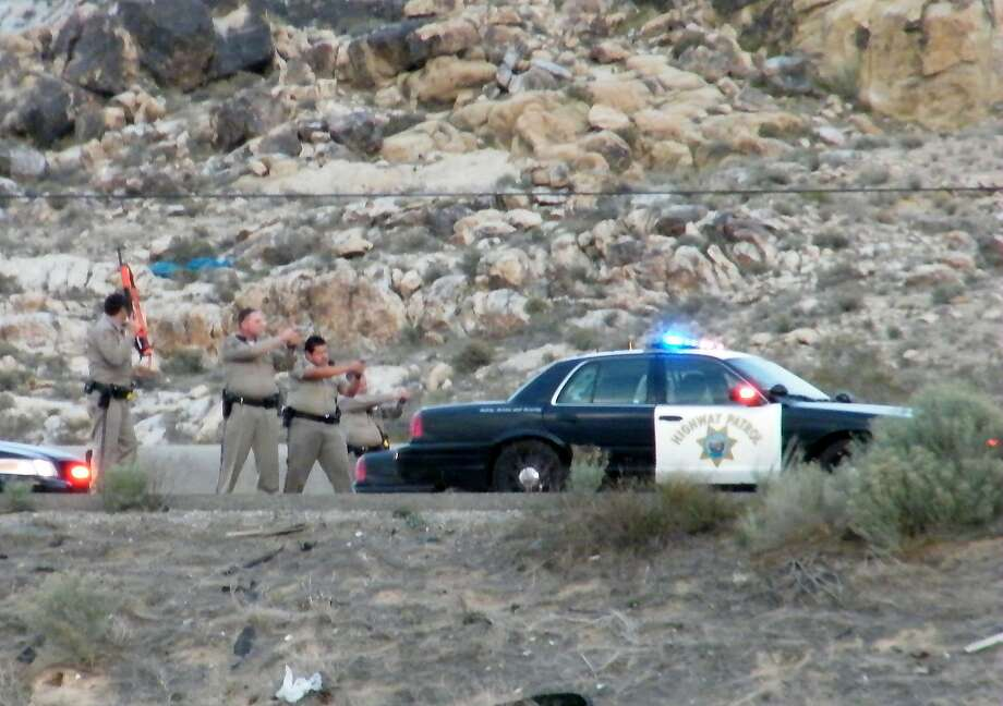 California Highway Patrol officers draw their weapons as they arrest former-Nevada Assemblyman Steven Brooks after a 20-minute chase in March 2013. Photo: Jennifer Simpson, Associated Press
