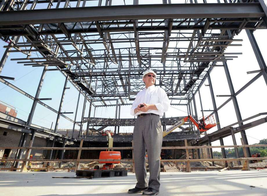 Walter Chabla, an architect for Perkins + Will, walks on the main stage area during a tour of the MISA performing-arts complex that is under construction at Greenwich High School, Tuesday, July 22, 2014. Photo: Bob Luckey / Greenwich Time