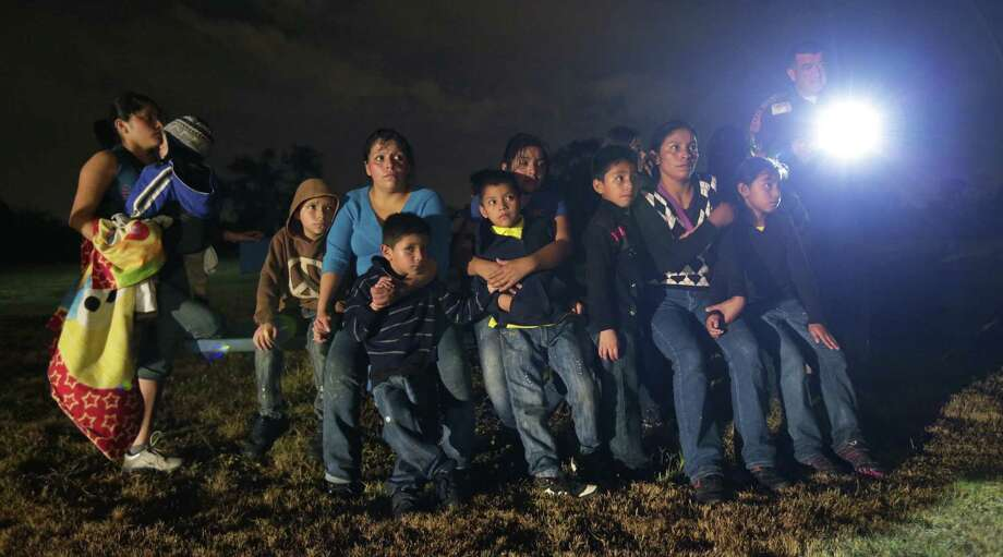 Immigrants from Honduras and El Salvador are stopped in Granjeno. Readers see the influx of immigrant children fleeing to the U.S. as a humanitarian crisis. Photo: Eric Gay / Associated Press / AP