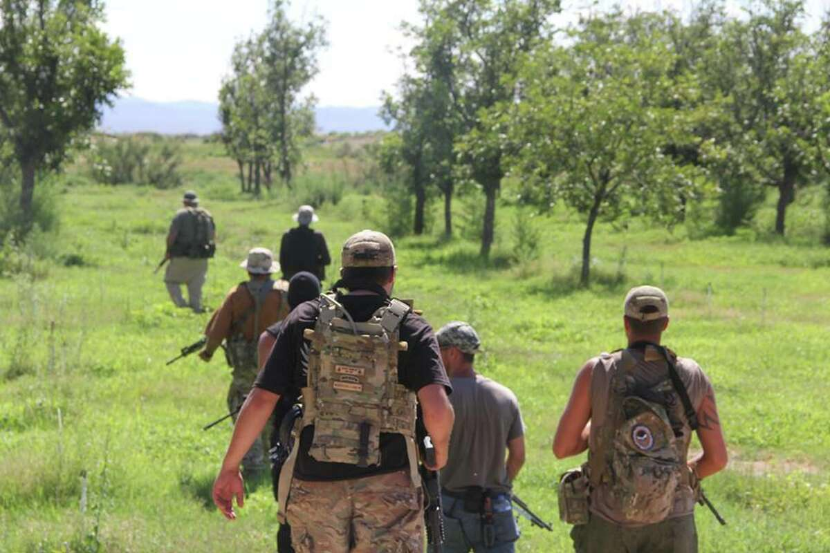 Photos showing dozens of members of the militia groups on the U.S.-Mexico border carrying semi-automatic rifles and wearing masks, camouflage and tactical gear provide one of the first glimpses into the group's activities on the border.