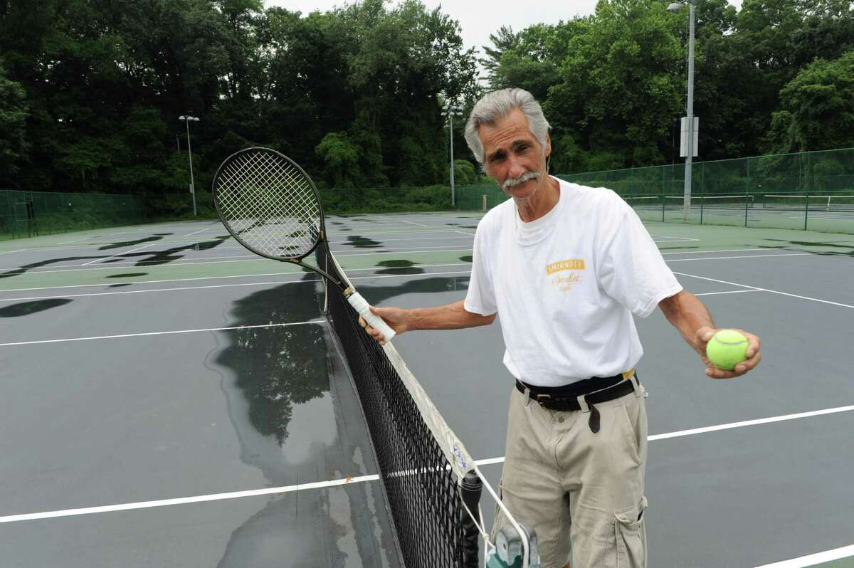 Michael Sette (77) plays tennis in Scalzi Park in Stamford, Conn. on Monday July 14, 2014.