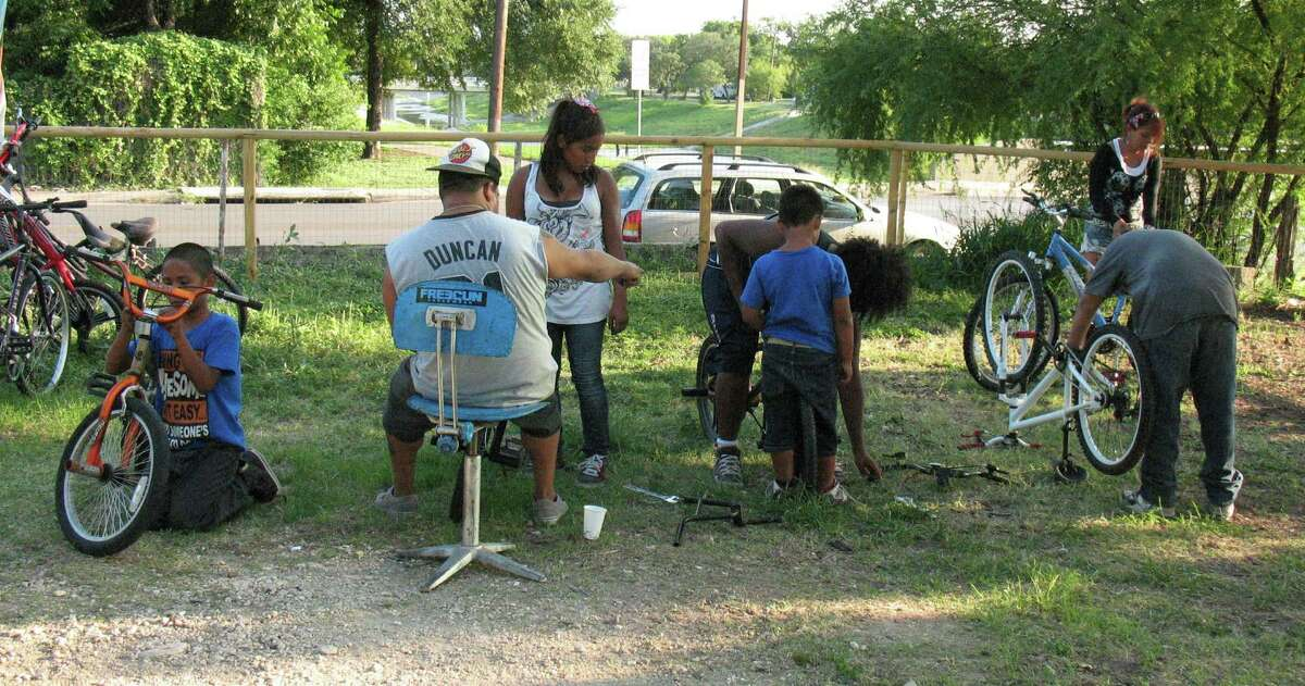The Earn-A-Bike Co-op, which opened on June 14, allows people to earn a bike by volunteering to repair and maintain other people's bikes.