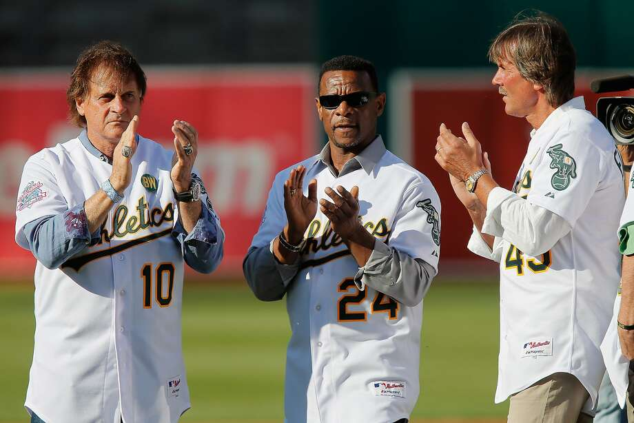 Tony La Russa (left),  Rickey Henderson and Dennis Eckersley celebrate the silver anniversary of the 1989 A's championship. Photo: Brian Bahr, Getty Images