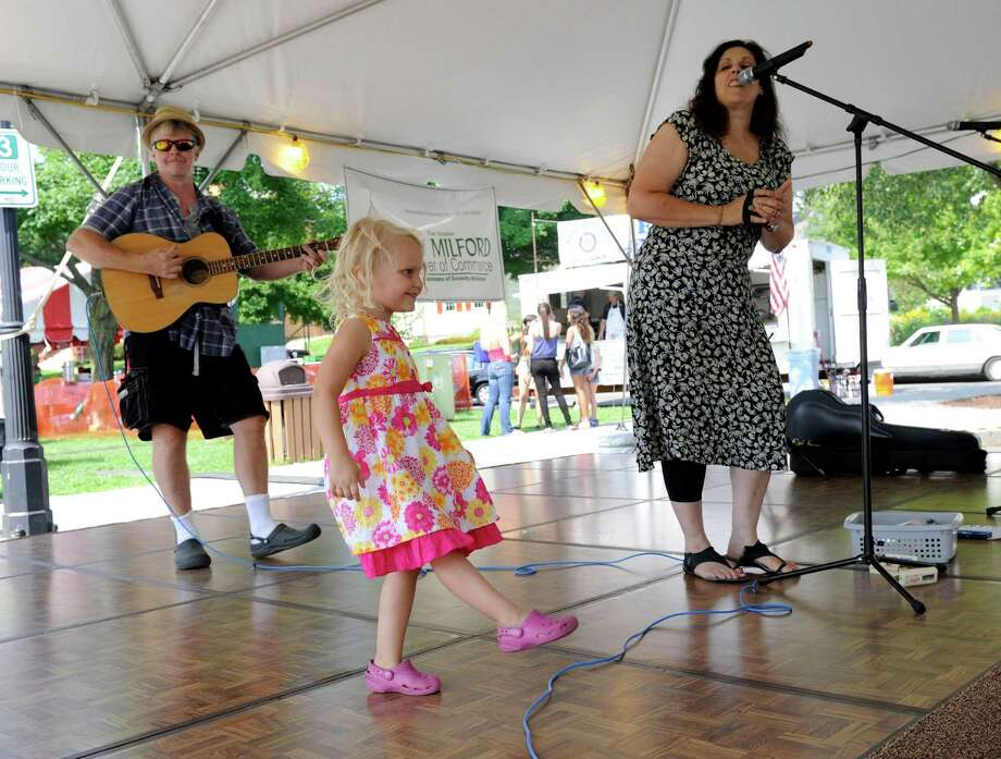 Payton Leroy, 4, of New Milford, Conn., takes the stage with The Blue Yodels at New Milford's Village Fair Days, Friday, July 25, 2014.