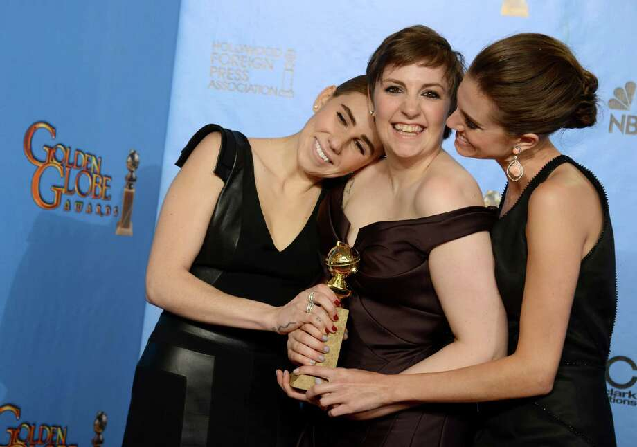 "Lena Dunham, center, is pictured with Zosia Mamet, left, and Allison Williams after ""Girls"" won the award for best television series - comedy or musical at the 70th annual Golden Globe Awards in 2013. Dunham will appear in Austin in October to promote her upcoming book, ""Not That Kind of Girl."" Photo: Jordan Strauss, INVL / Invision"