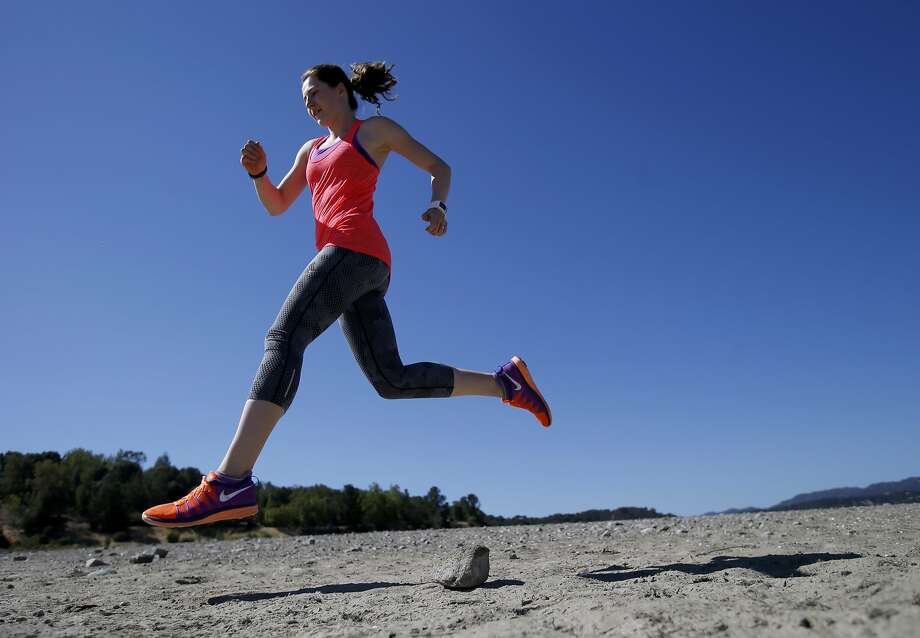 Karen Poole trains at Lake Mendocino, near Ukiah. She learned the hard way to plan a post-race recovery. Photo: Brant Ward, San Francisco Chronicle