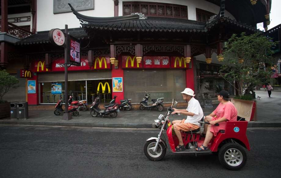 China: A McDonald's restaurant opens its doors early on July 24, 2014 in Shanghai. Chinese police on July 23 detained five people from a unit of US food supplier OSI Group, officers said, in a case involving expired meat sold to fast food giants including McDonalds and KFC. Photo: JOHANNES EISELE, AFP/Getty Images