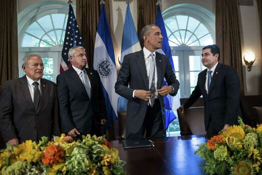 From left President of El Salvador Salvador Sanchez Ceren, President of Guatemala Otto Perez Molina, US President Barack Obama and President of Honduras Juan Orlando Hernandez stand up after a meeting in the Cabinet Room of the White House July 25, 2014 in Washington. The four presidents met to speak about the amount of immigrants, specifically children, leaving the Central American region for other countries including the United States.    AFP PHOTO/Brendan SMIALOWSKIBRENDAN SMIALOWSKI/AFP/Getty Images Photo: BRENDAN SMIALOWSKI, AFP/Getty Images / AFP