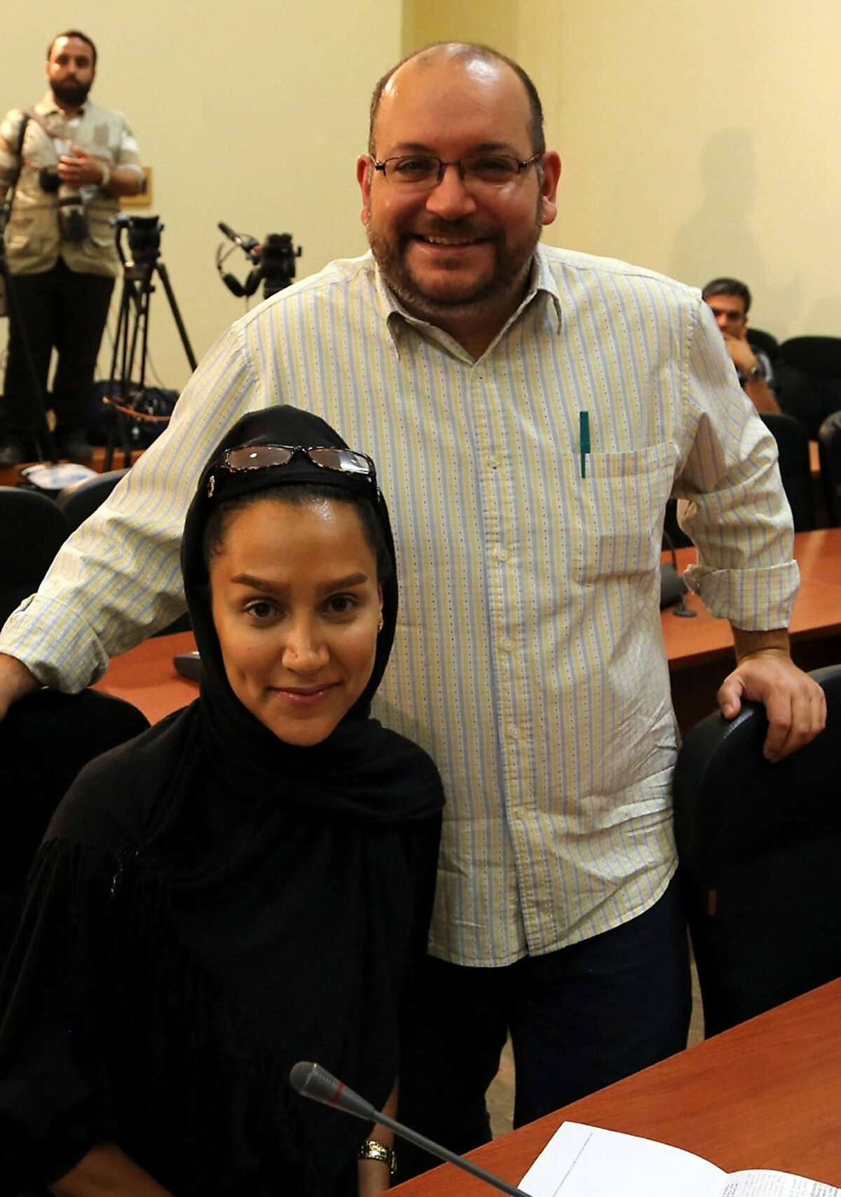 A file picture shows Iranian-American Washington Post correspondent Jason Rezaian and his Iranian wife Yeganeh Salehi posing while covering a press conference at Iran's Foreign Ministry in Tehran, on September 10, 2013. Tehran's chief justice Gholamhossein Esmaili confirmed the arrest of Washington Post correspondent Jason Rezaian and his wife, also a journalist, the official IRNA news agency reported. Rezaian, 38, has been the Post correspondent in Tehran since 2012 and holds both American and Iranian citizenship, according to the newspaper and his wife is an Iranian who has applied for US permanent residency and works as a correspondent for The Nation newspaper based in the United Arab Emirates, the Post said.