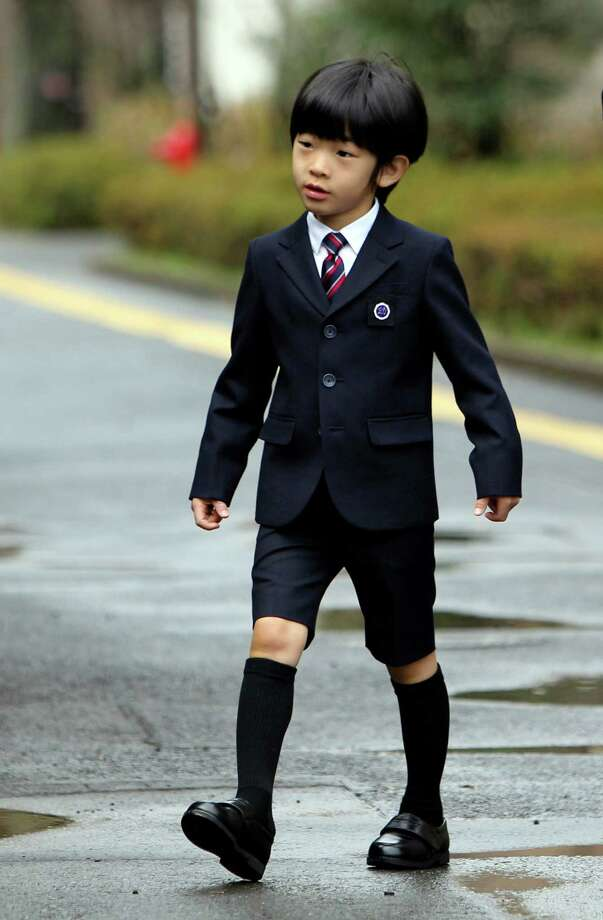 Prince Hisahito, the third child and only male heir of Fumihito, Prince Akishino of Japan, and Kiko, Princess Akishino. Hisahito is third in line to the throne, after his father. His grandfather is His Imperial Majesty the Emperor, Akihito. Japanese rules of succession do not allow for female heirs to inherit the throne. Hisahito's birth ended a possible crisis of lineage. Hisahito is show here arriving at his kindergarten graduation ceremony in March of 2013.  Photo: JUNJI KUROKAWA, Getty / 2013 AFP