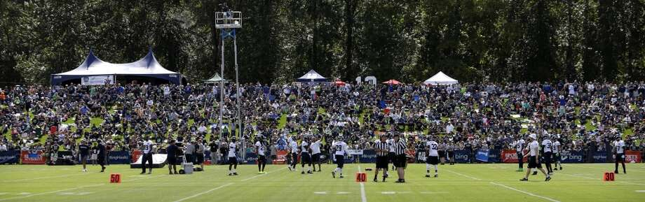 Seattle Seahawks fans watch the team's NFL football camp practice Friday. Photo: Associated Press