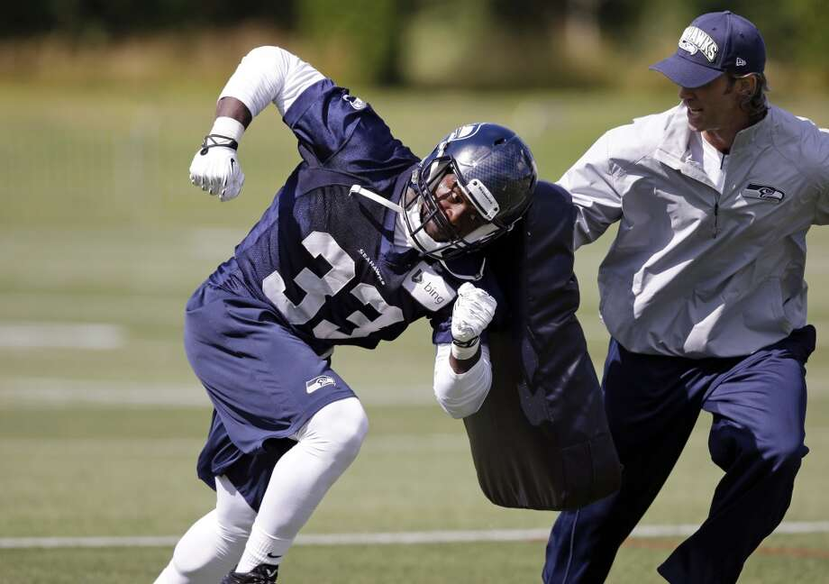Seattle Seahawks' Christine Michael (33) runs through a drill at an NFL football camp practice Friday. Photo: Associated Press
