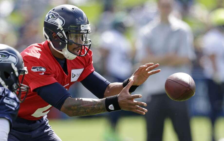 Seattle Seahawks quarterback Terrelle Pryor takes a snap at an NFL football camp practice Friday. Photo: Associated Press