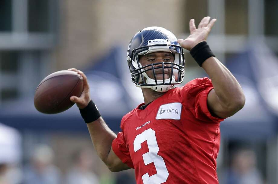 Seattle Seahawks quarterback Russell Wilson drops back to pass at an NFL football camp practice Friday. Photo: Associated Press