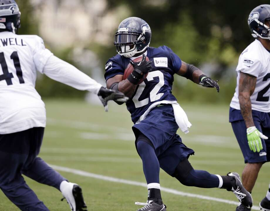 Seattle Seahawks' Robert Turbin (22) runs through a drill at an NFL football camp practice Friday. Photo: Associated Press