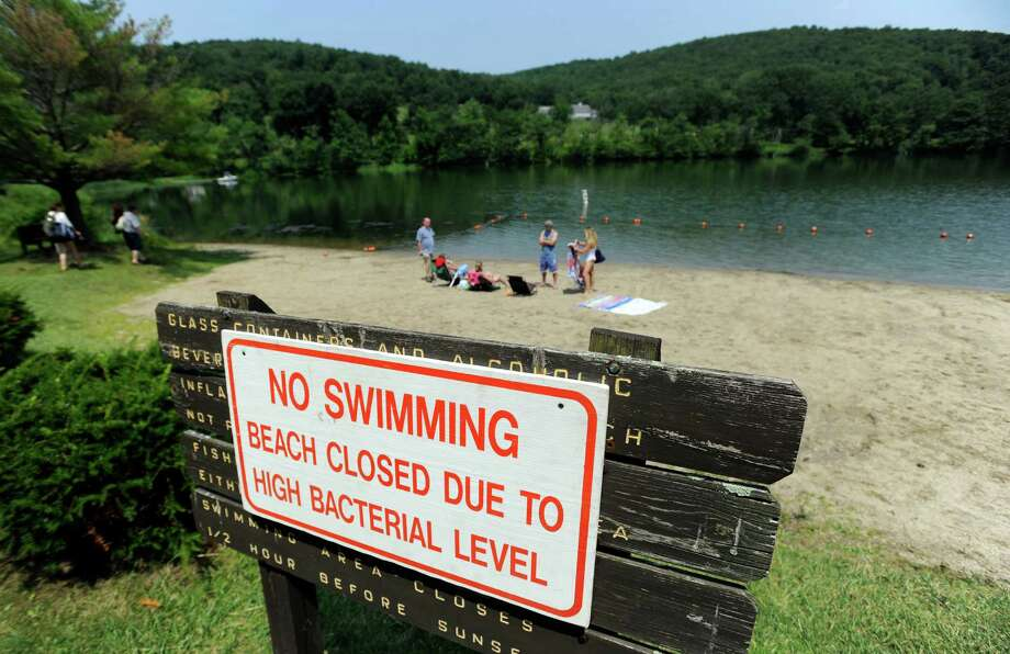 The beach at Lake Waramaug State Park in Kent, Conn., was closed for swimming, Friday, July 25, 2014. Photo: Carol Kaliff / The News-Times