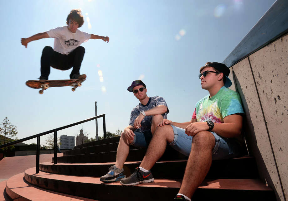Dakota DeVille leaps over Andrew Borel, left, and Aaron Alford at the Beautiful Mountain Skate Park in Beaumont on Thursday. Borel 'Buddy B' and Alford 'Midnight Cobra' will perform this Saturday at the park in the city's downtown concert series. Other venues in the series will include jazz at the Event Centre and movies at the Jefferson Theatre.  Photo taken Thursday, July 24, 2014 Guiseppe Barranco/@spotnewsshooter Photo: Guiseppe Barranco, Photo Editor