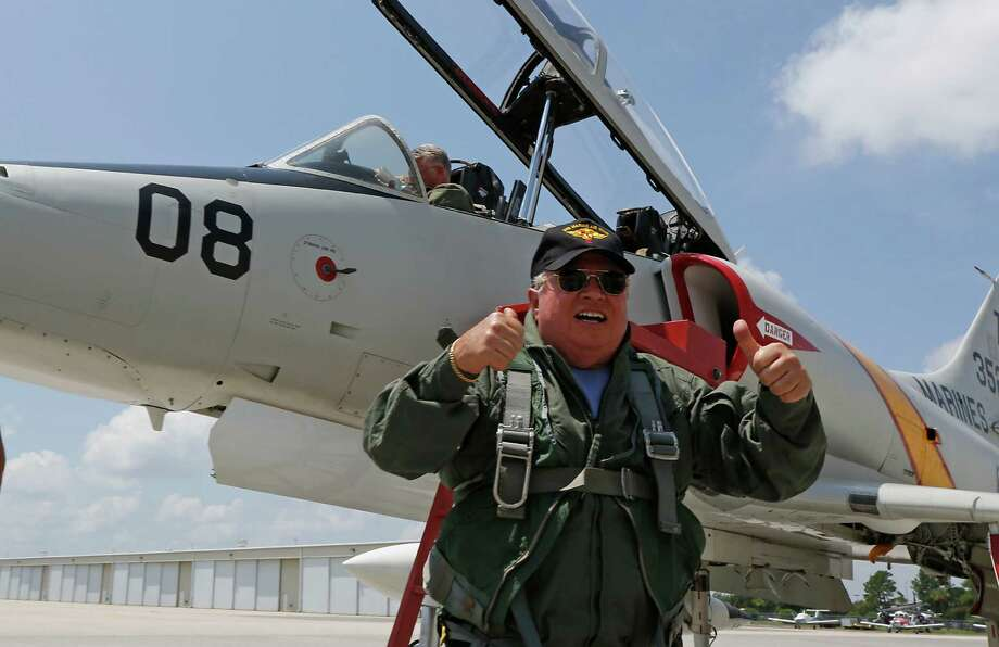 Al La Rocca gives a thumbs up after a flight in an A-4 Skyhawk at Ellington Field, La Rocca a Vietnam Marine Veteran and pilot from Memphis, Tenn. won a charity auction with a bid of $10,000 to have the chance to fly an A-4 Skyhawk, the type of plane he flew during Vietnam Friday, July 25, 2014, in Houston. The donation was to the Marine Corps Scholarship Foundation, a provider of need-based scholarships to military children and children who have lost parents who served in the military. Photo: James Nielsen, Houston Chronicle / © 2014  Houston Chronicle