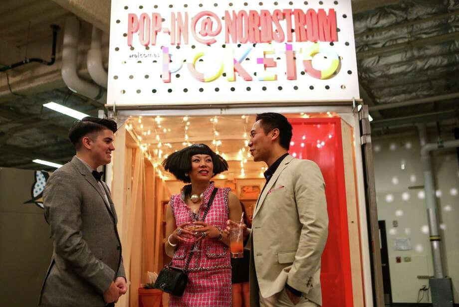 """From left, Taylor Britton, Coco Nagle and Mike Simbre enjoy the cocktail hour during the annual Nordstrom Designer Preview fashion show at Smith Cove Event Center at Pier 91 in Seattle. The event helped raise funds for Seattle Art Museum and incorporated elements of  the Museum's upcoming exhibit """"Pop Departures"""" into the show. Photographed on Thursday, July 24, 2014. Photo: JOSHUA TRUJILLO, SEATTLEPI.COM / SEATTLEPI.COM"""